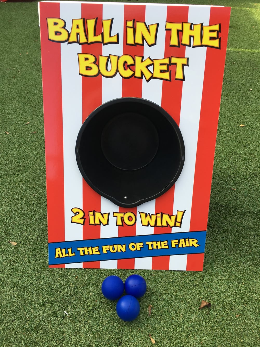 Ball in a bucket carnival game