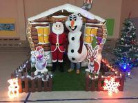 santas grotto with decorations and olaf and santa mascot